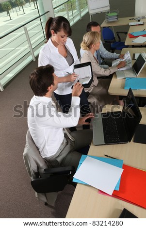 Colleagues working in a office - stock photo