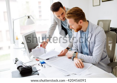 Colleagues working in office and brainstorming - stock photo