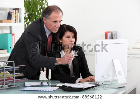 Colleagues working on a project together - stock photo