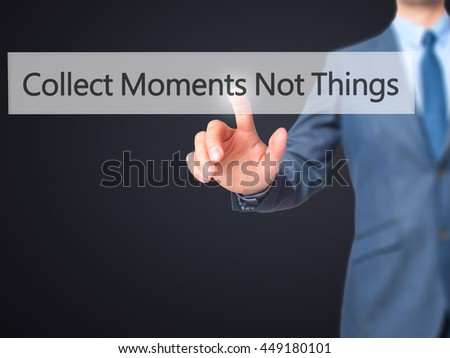 Collect Moments Not Things - Businessman click on virtual touchscreen. Business and IT concept. Stock Photo - stock photo