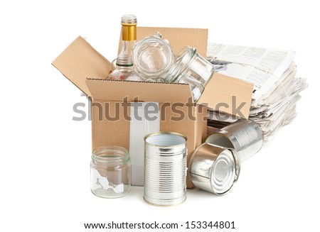 Collected glass bottles, tin cans and newspaper in carton box for recycling on white background - stock photo