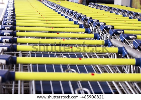 Collected in the number of shopping carts around a supermarket, blue and yellow