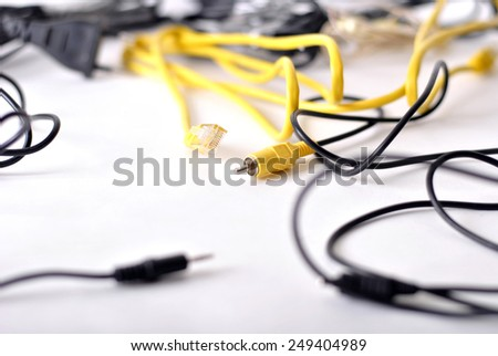 collected into bundles wires and adapters for different devices on a white background  - stock photo