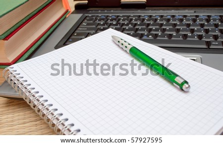 Collected notes over a laptop and from books - stock photo
