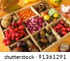 Collecting box with walnuts, chestnuts and other fall fruits - stock photo