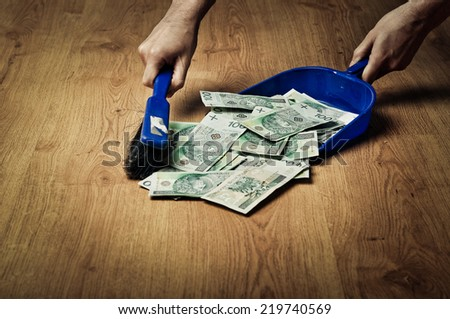 Collecting money from the floor - stock photo