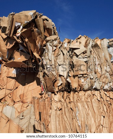 collecting waste paper and cardboards for recycling - stock photo