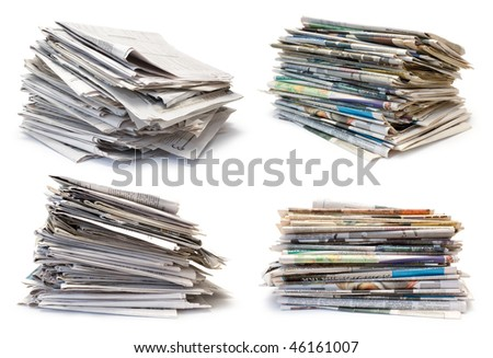Collection from four packs of newspapers on white background
