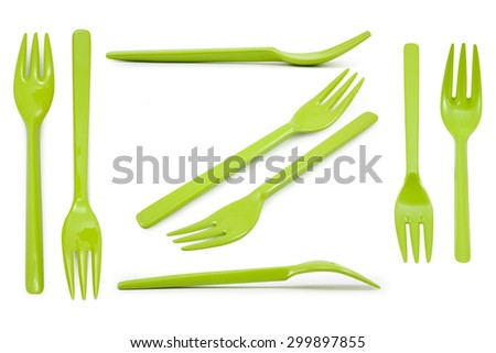 Collection  green plastic forks isolated on white background