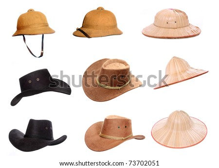 Collection of a helmets and hats for tropical destinations. - stock photo