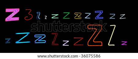 collection of a number of different neon letter Z isolated on black - part of a series of neon letters - stock photo