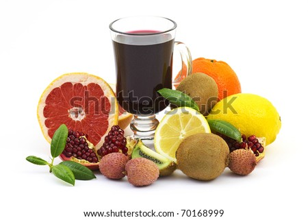 Collection of a ripe tropical fruits and pomegranate juice