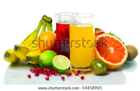 Collection of a ripe wet tropical fruits with juice glasses - stock photo