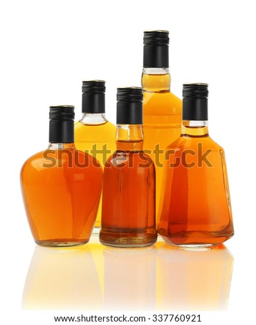 Collection of Alcoholic Drinks in Glass Bottles on White - stock photo