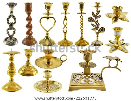 Collection of antique candle holders isolated on white - stock photo