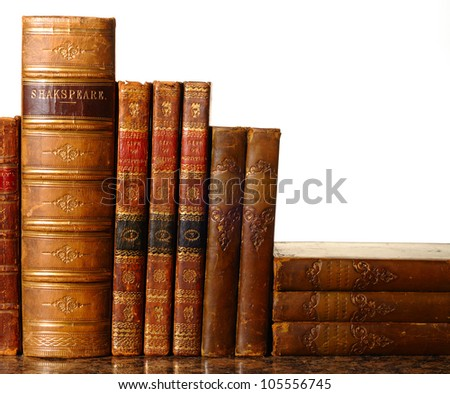 Collection of antique leather-bound books against a white background. Ancient spelling 'Shakespeare' - stock photo