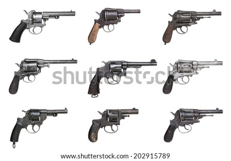 Collection of antique revolvers isolated on white - stock photo