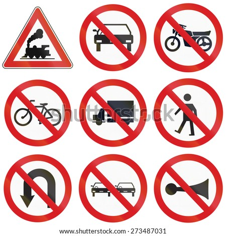 Collection of Argentinian prohibition signs and railway warning. - stock photo