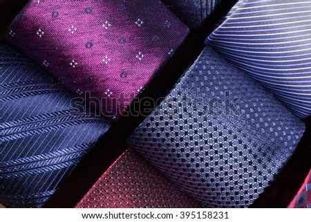 collection of assorted man's ties. Coiled ties in store's display