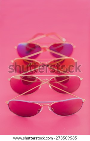 Collection of aviator stile sunglasses on pink background - stock photo