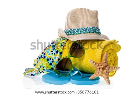 Collection of beach items - towel, flip-flops, sunglasses, swimsuit and hat isolated on white. - stock photo