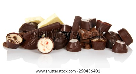 Collection of beautiful delicious chocolate candies isolated on white - stock photo