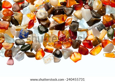 collection of beautiful precious stones against white background - stock photo