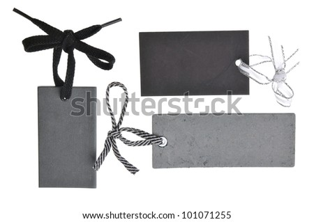 collection of blank black cardboard paper labels isolated on the white background - stock photo