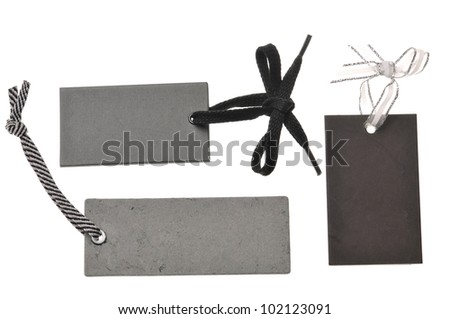 collection of blank black cardboard paper labels or tag isolated on the white background - stock photo