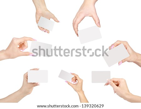 Collection of blank cards in a hand isolated on white. - stock photo