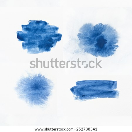 Collection of blue watercolor brushes on white paper background. - stock photo