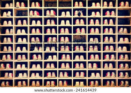 Collection of bowling shoes in their rack background, vintage process - stock photo