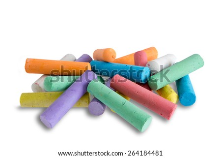 Collection of bright colorful chalk crayons piled in a random heap ready for young elementary school children to use for creative drawing and entertainment, on white - stock photo