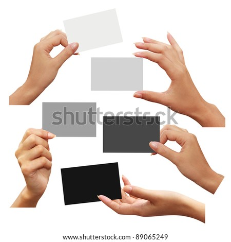 Collection of business card white, gray, and black in hand on white background - stock photo