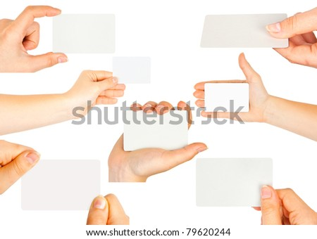 Collection of card blank in a hand on white background - stock photo