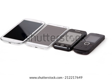 collection of cell phones, old design and new smart phones isolated on white