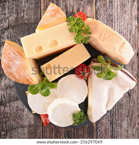 collection of cheese on wood background - stock photo
