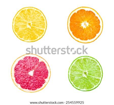 Collection of citrus slices - orange, lemon, lime and grapefruit isolated on white background - stock photo