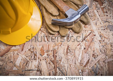 Collection of claw hammer building helmet leather gloves construction concept. - stock photo
