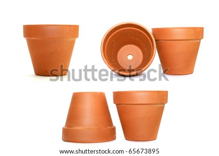 collection of clay flower pots over white background