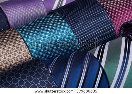 Collection of coiled neckties macro photo. Fashion background