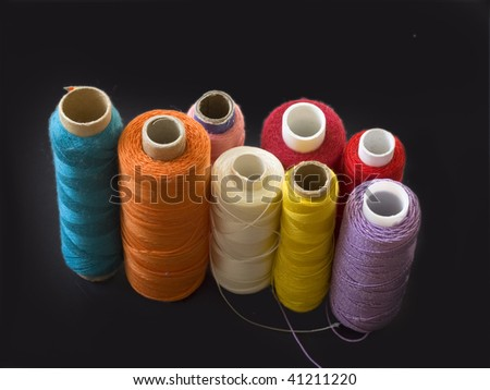 collection of colorful bobbins - stock photo
