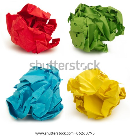 collection of colorful crumpled papers over white background - stock photo