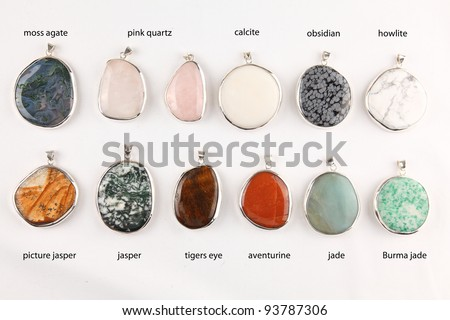 Collection of colorful different gemstone pendants with sterling silver - stock photo