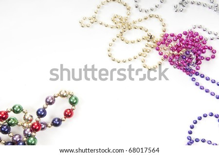 collection of colorful mardi gras beads - stock photo