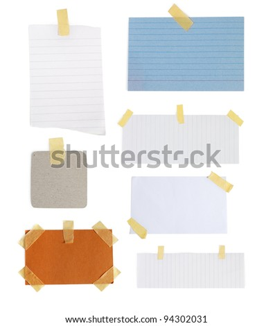 collection of colorful note papers with tape on white background