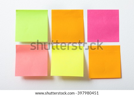 collection of colorful post it paper note on white background - stock photo