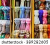 Collection of colorful scarfs on a shop window - stock photo