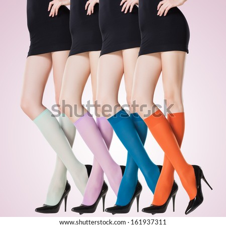 collection of colorful short stockings on sexy woman legs - stock photo
