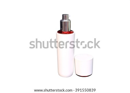 Collection of cream and lotion containers on white background